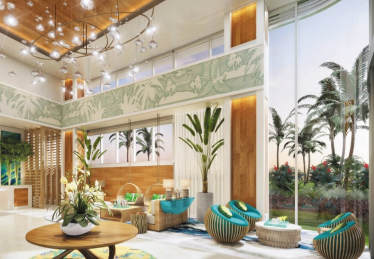 the lobby of the pointe luxury resort in the bahamas